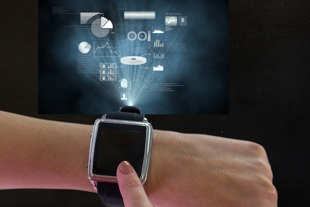 Finger touching the smartwatch's screen
