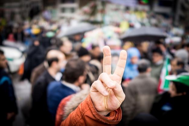 Finger victory symbol on protest