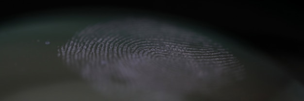 Fingerprint mark on clear glass as crime evidence