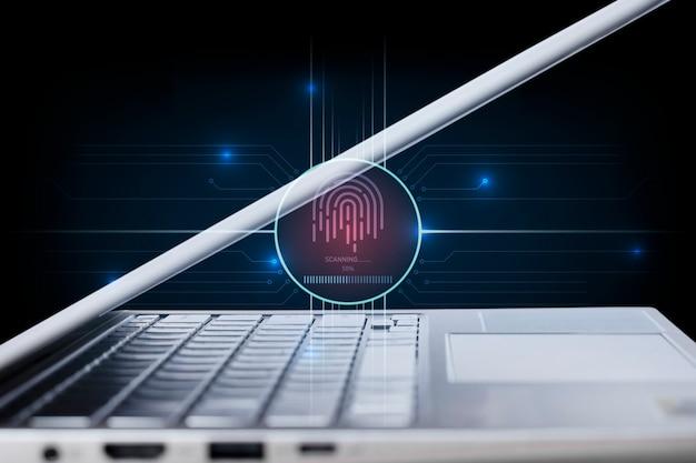黒の背景にコンピューターのラップトップを備えた指紋スキャナーのセキュリティ技術。