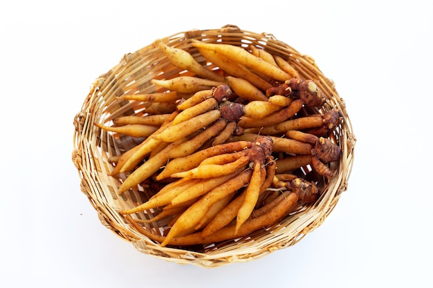 Fingerroot in bamboo basket on white background.