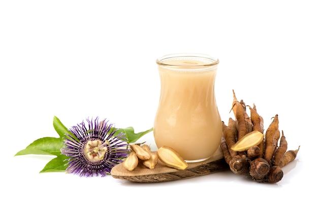 Fingerroot or galingale rhizome and juice isolated on white background.