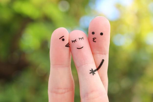 Искусство пальцев. концепция мальчиков целует девушку в щеку.