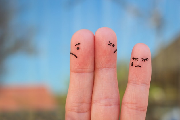 Fingers art of couple after an argument looking in different directions