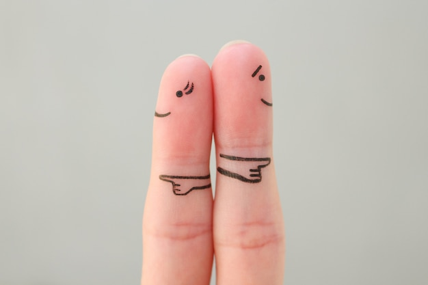 Fingers art of couple. concept of a couple pointing in different directions.