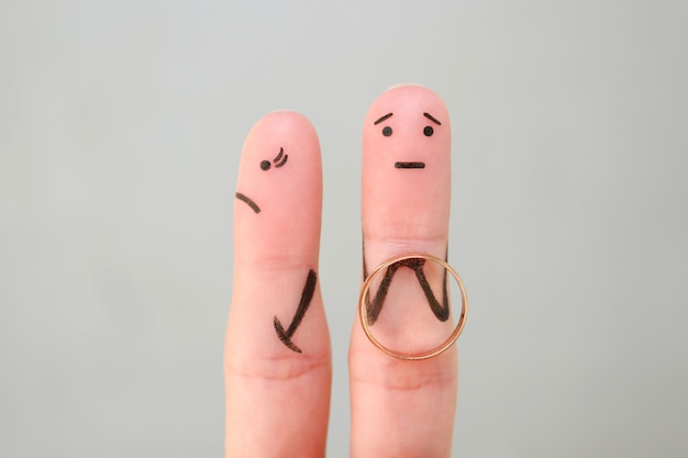 Fingers art of couple. concept man made an offer to get married, woman refused.