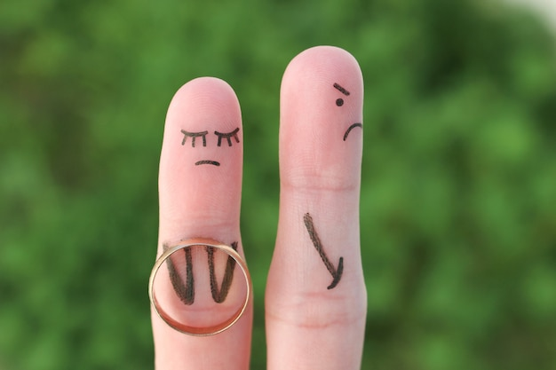 Fingers art of couple. concept woman made an offer to get married, man refused.