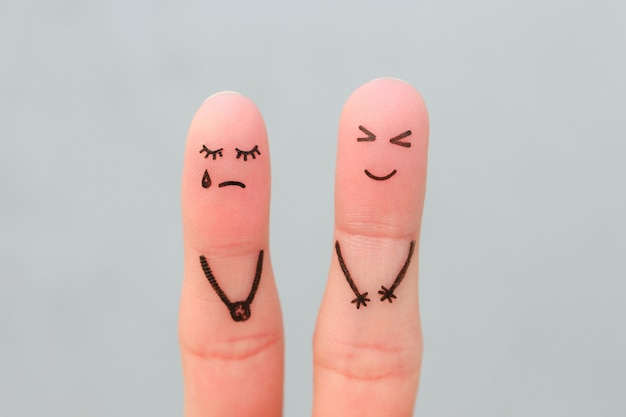 Fingers art of couple. woman cries, man laughs.