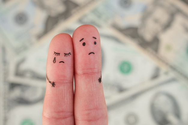 Fingers art of displeased couple on background of money