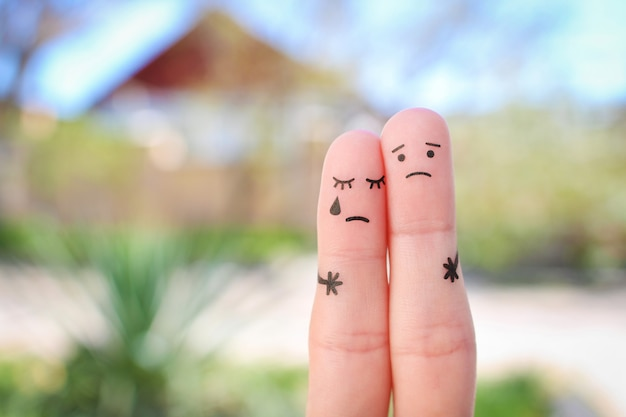Fingers art of displeased couple. concept of solution to the problems of family, support in difficult situations.