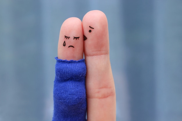 Fingers art of displeased couple. pregnant cries, man reassures her.
