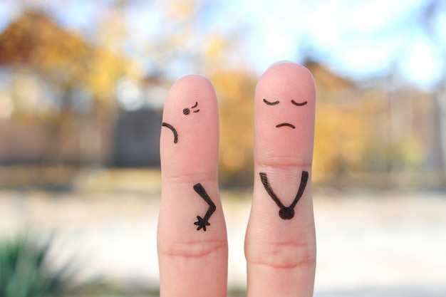 Fingers art of displeased couple. woman was offended, man was guilty.
