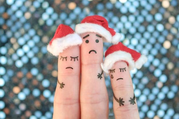 Fingers art of displeased family celebrates christmas.