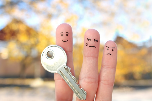 Fingers art of family during quarrel. concept of man and woman cannot divide property after divorce.