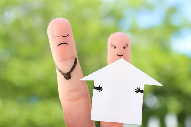 Fingers art of family during quarrel. concept of man and woman divide house after divorce.