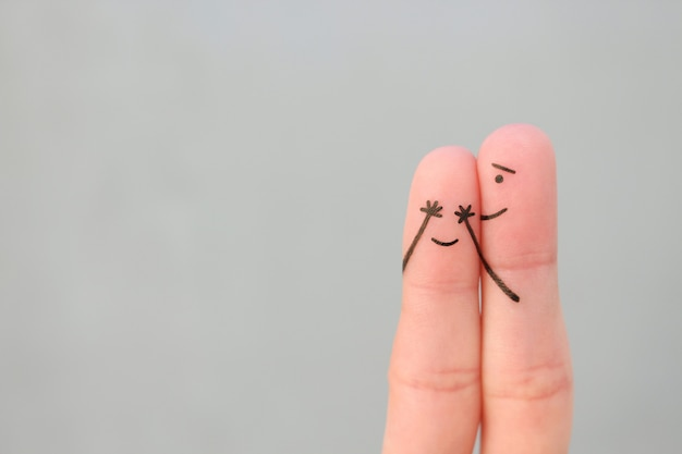 Fingers art of happy couple. boy closed her eyes to girl. concept of girl guessed who closed his eyes.