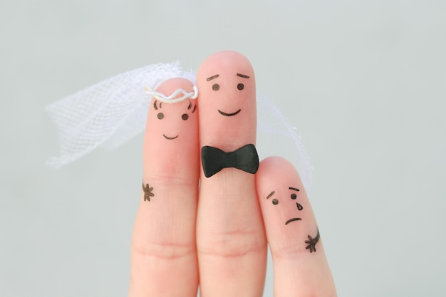 Fingers art of happy couple to get married. concept of stepson vs wedding.