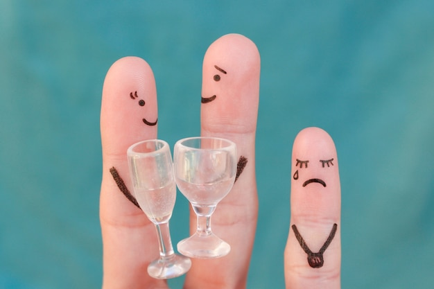 Fingers art of happy couple. man and woman drink alcoholic beverages. child is angry and resentful.