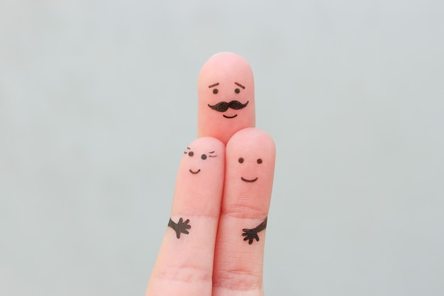 Fingers art of happy family. concept father hugs children.