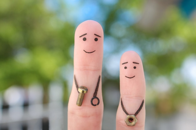 Fingers art of happy family. concept father teaches son to repair.