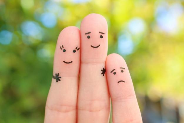 幸せなカップルの指アート。子供は怒っています。