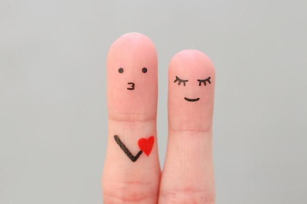 幸せなカップルの指アート。女性への彼の愛を告白する男の概念。