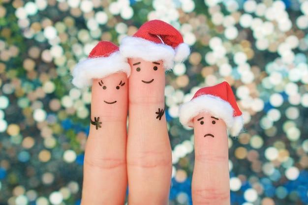 Пальцы искусство счастливая пара смеется в новогодних шапках. Premium Фотографии