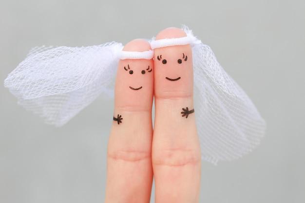 結婚する幸せな同性愛者のカップルの指の芸術。結婚式のコンセプト。