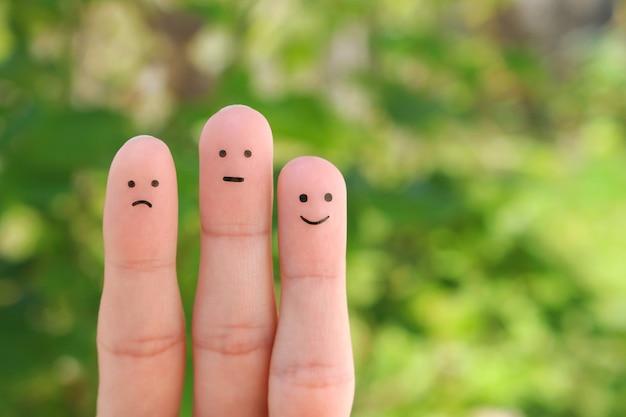 人の指アート。肯定的および否定的な感情の概念。