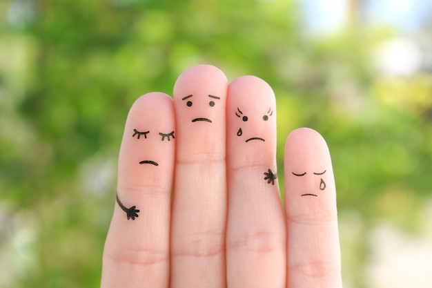 Fingers art of sad family. concept of support in difficult situations.