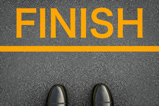 Finish concept with leather shoes at finish line