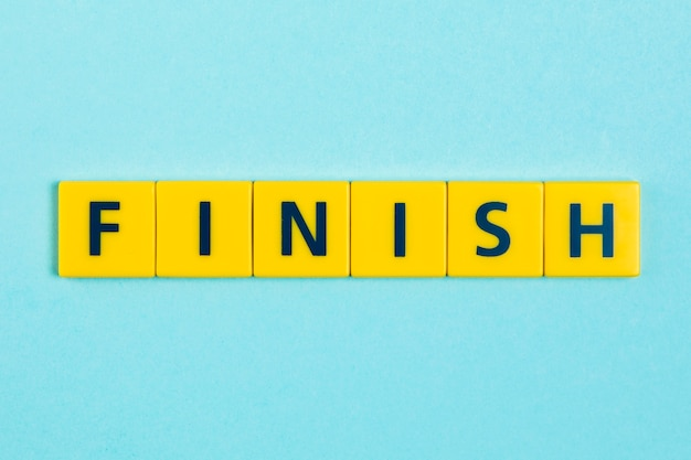Finish word on scrabble tiles