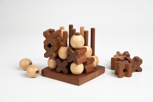The finished game of tic-tac-toe. three-dimensional wooden voluminous field for tic-tac-toe competition.