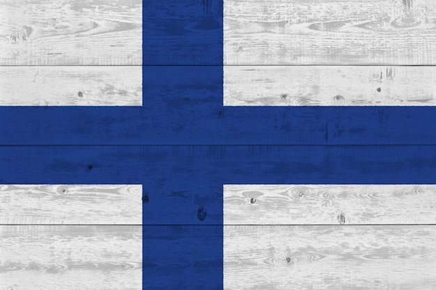 Finland flag painted on old wood plank