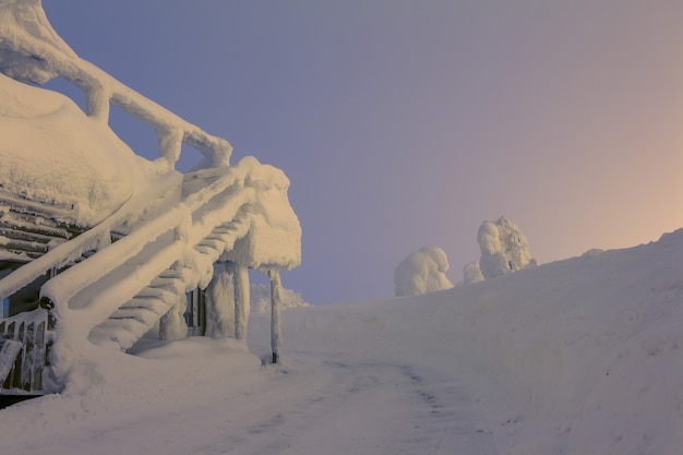 Finland. house with a staircase after a snowstorm. dawn