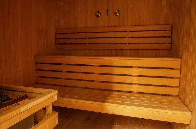 Finnish sauna interior finished with natural light wood