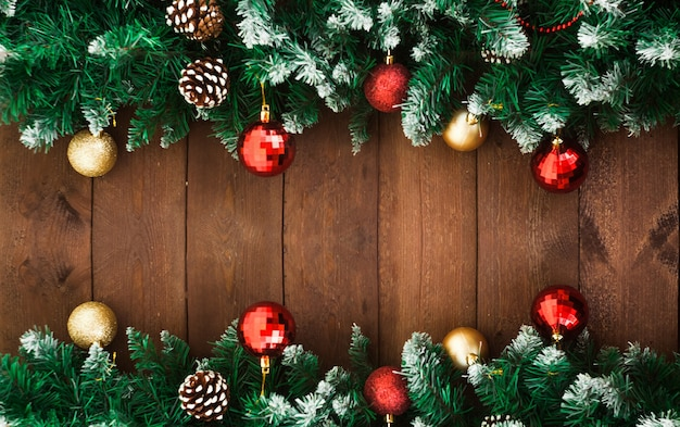 Fir branches with decoration on old dark wooden surface