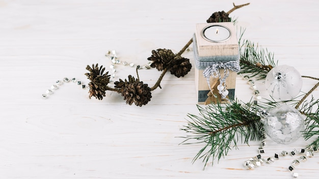 Fir tree branches with candle in candlestick