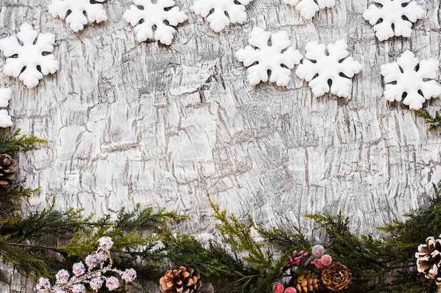 Fir tree branches with snowflakes