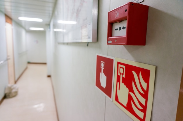 Fire alarm activation system with symbol on offshore drilling rig.
