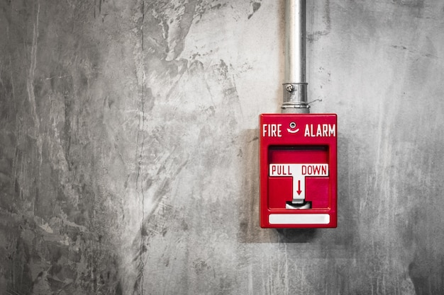 Fire alarm box on the wall of marble background
