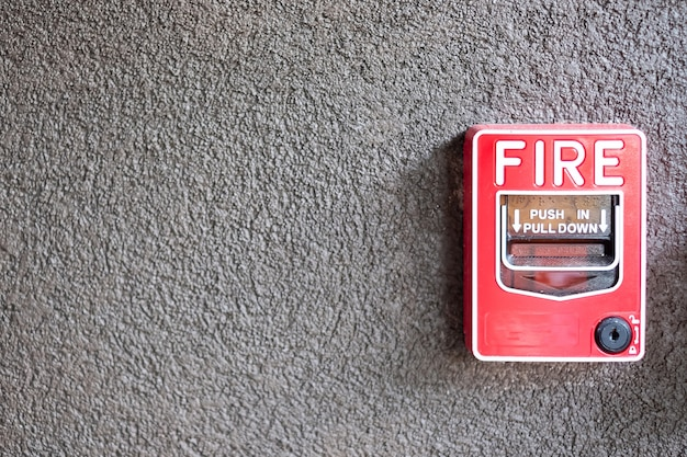 Fire alarm switch on the wall, powerful emergency equipment for industrial and residential
