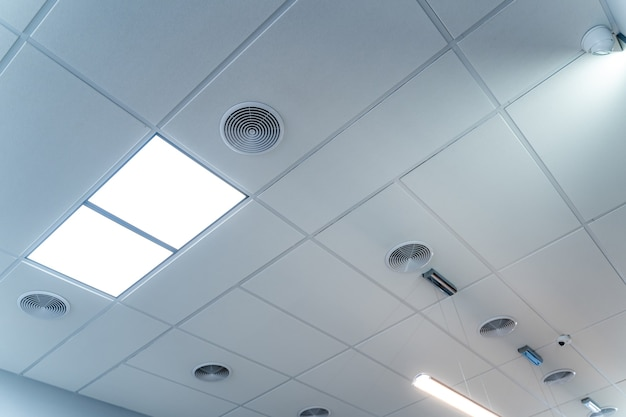 Fire alarm that is organized inside the building. part of ceiling in administrative building.