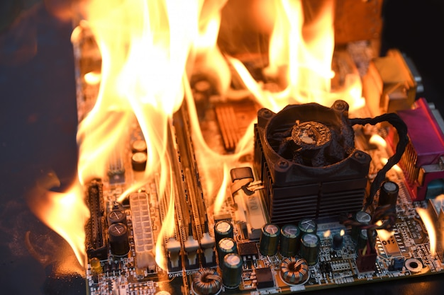 Fire burning ,blazing computer motherboard, cpu,gpu and video card, processor on circuit board with electronic