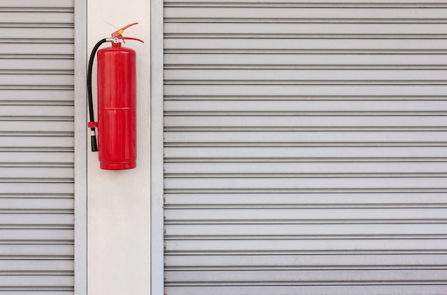 Fire extinguisher on the shutter door at home