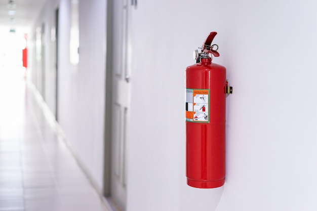Fire extinguisher on wall in building