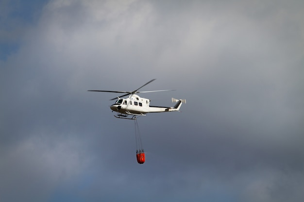 Fire fighting helicopter with bambi basket