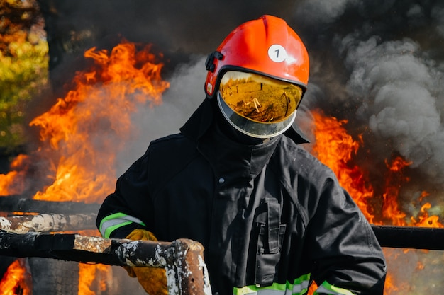 In to the fire, a firefighter searches for possible survivors