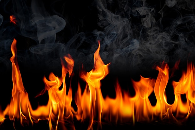 Fire flames with smoke on black background burning red hot sparks rise fiery