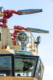 Fire hydrant on a sea-boat against the blue sky